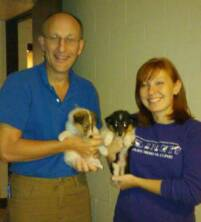 Dr and Grad student with puppies